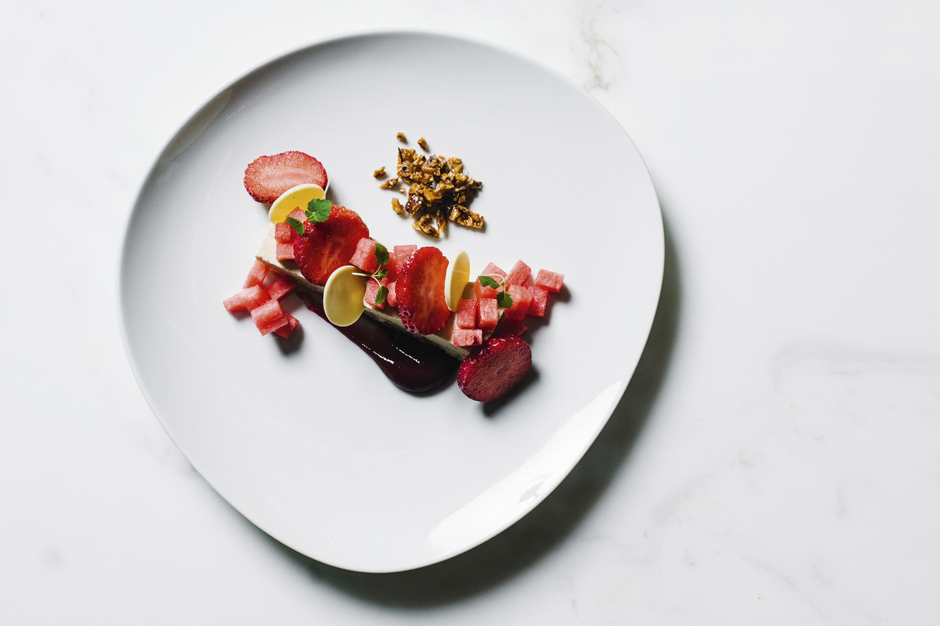 Coconut cake with strawberry sorbet and watermelon by Daniel Menzie, Wilmot ©Signe-Birck | Story on a Plate, Gestalten 2019