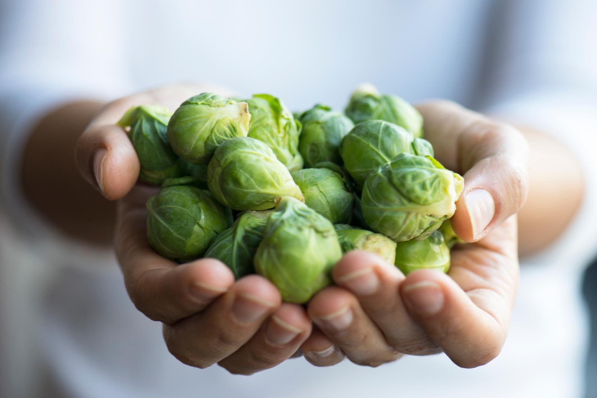 hands holding brussels sprouts ©iStock