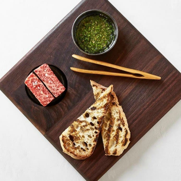 Japanese Wagyu Beef with Bone Marrow Gremolata cooked on a Lava-stone