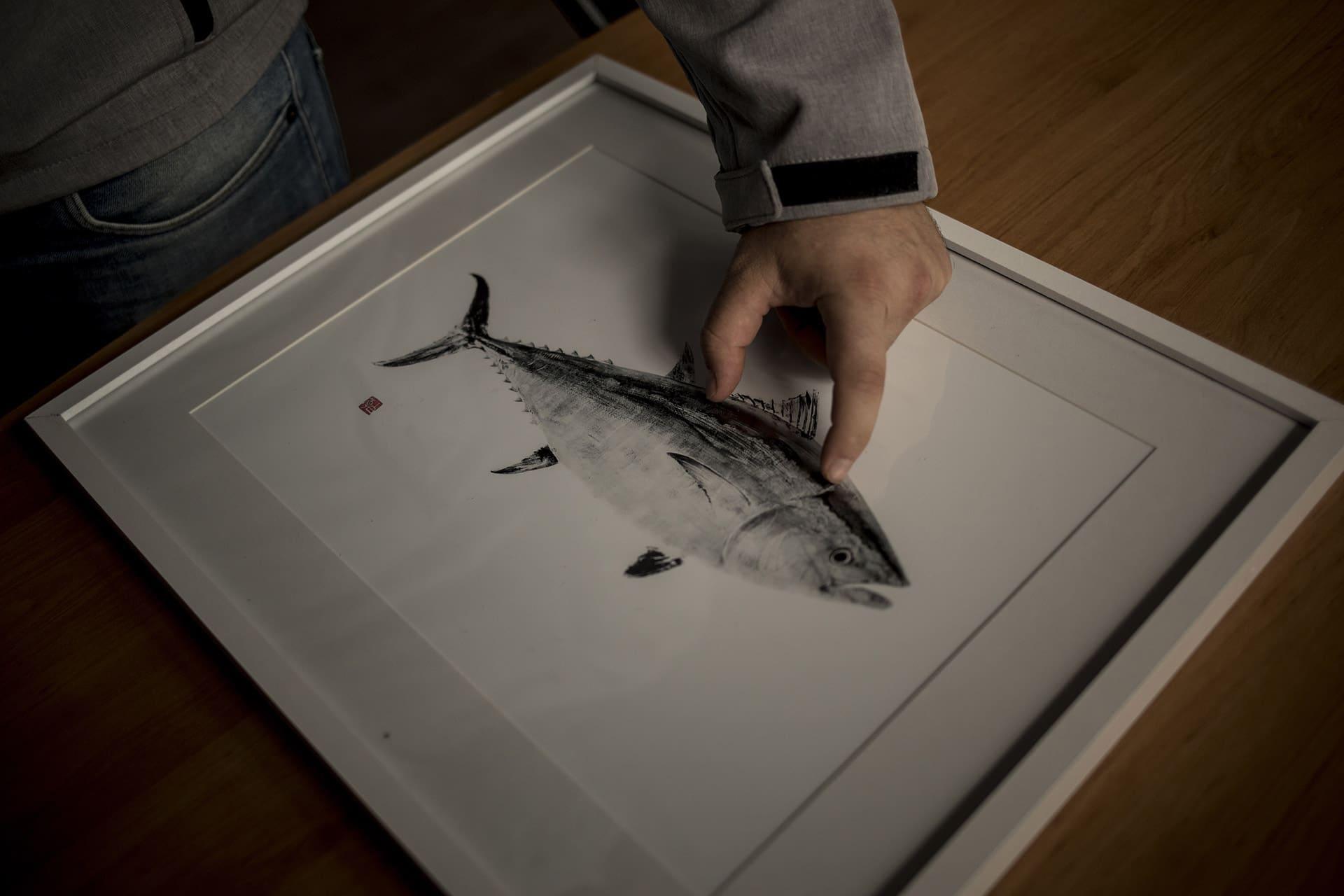 Man measuring tuna