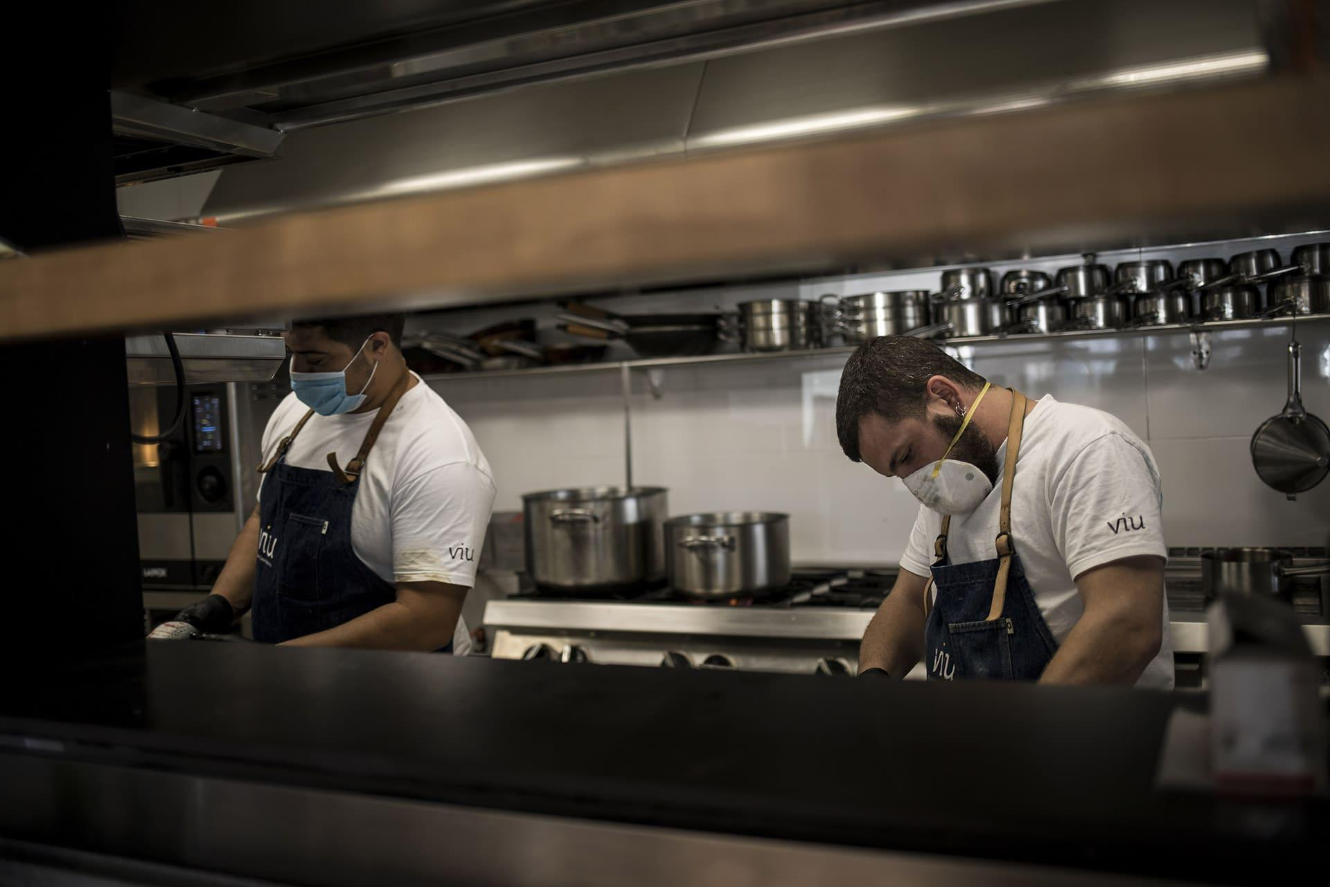 two chefs working in a restaurant