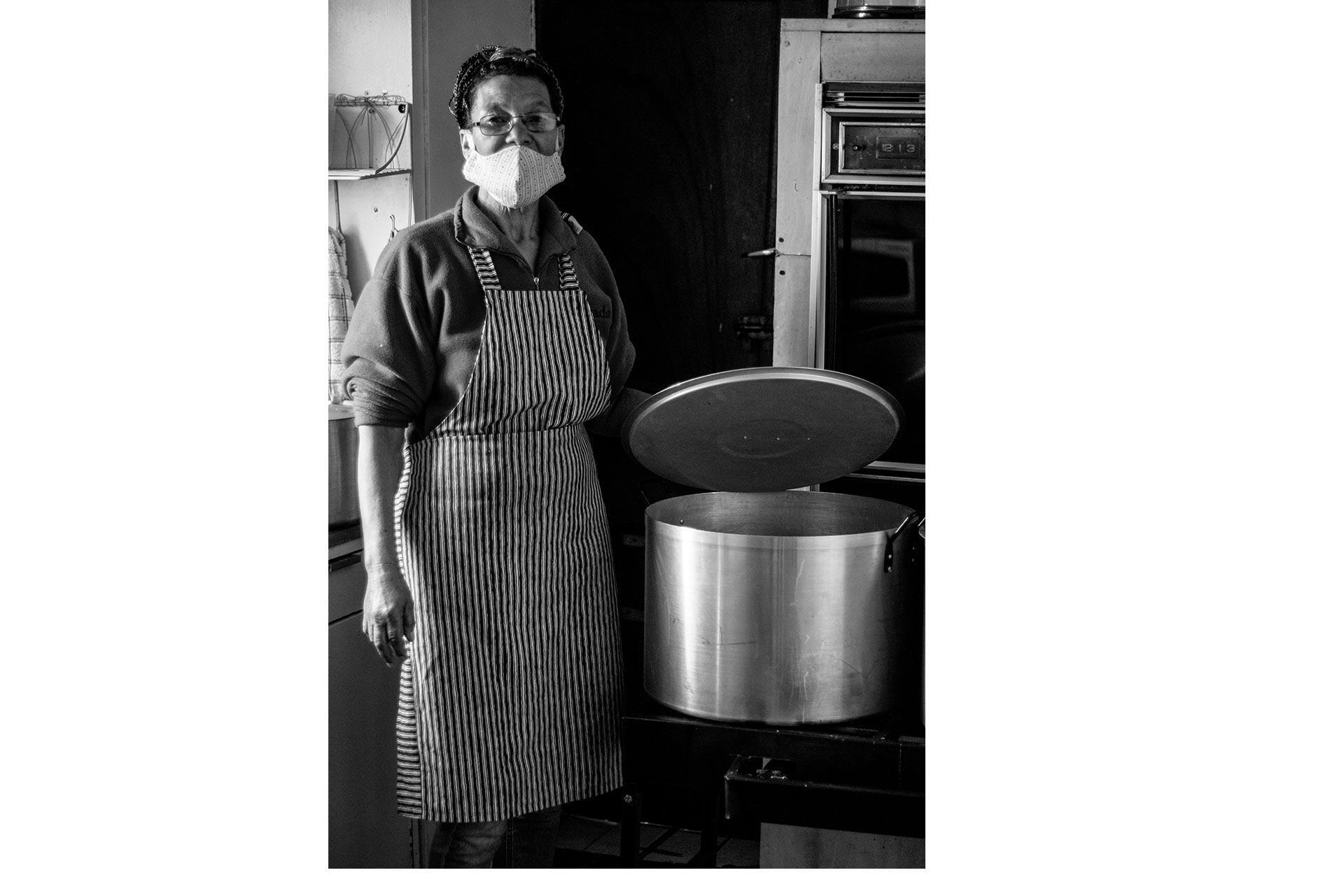 Old lady preparing food