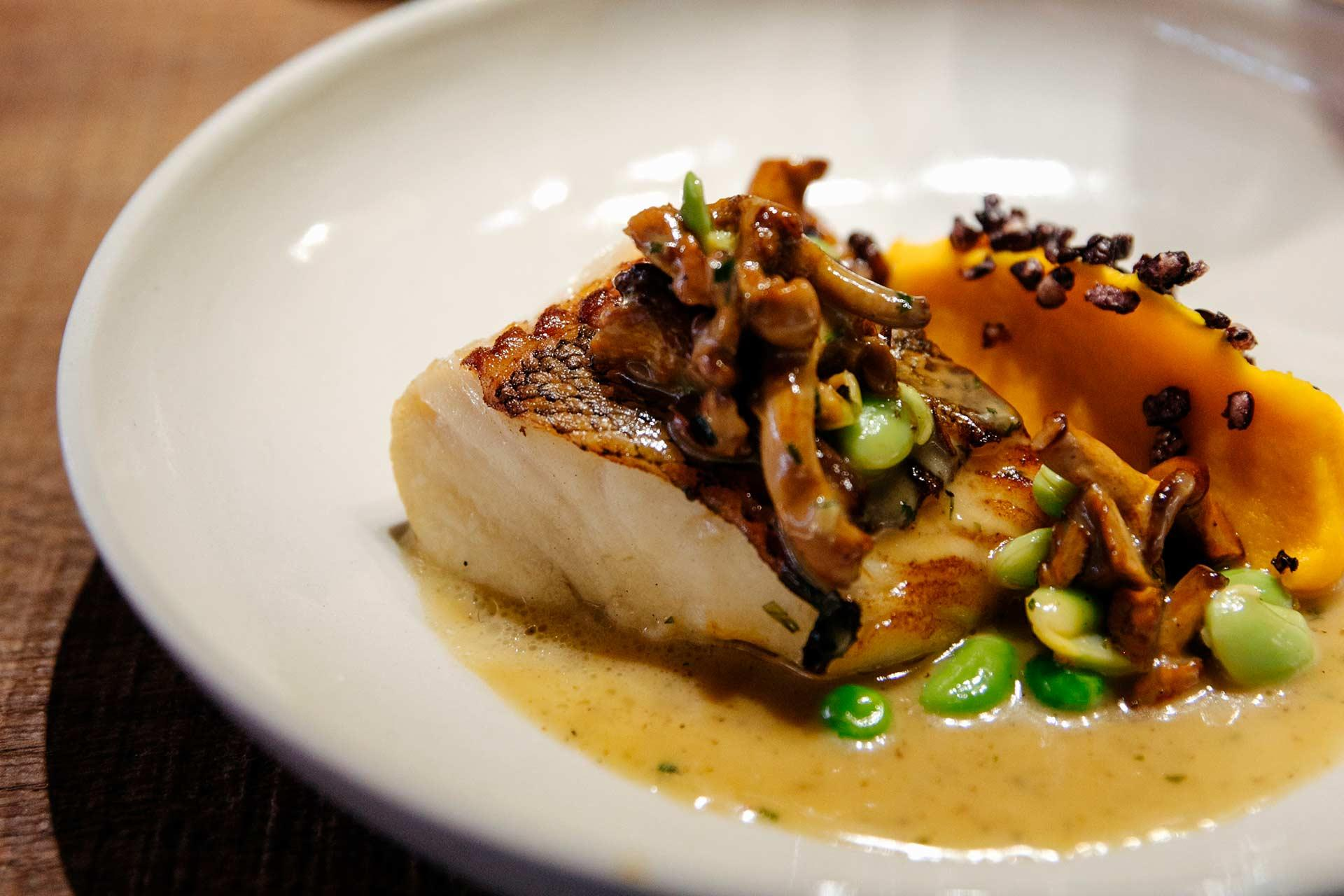 Patagonian toothfish, baked sweet potato cream with miso paste, chanterelle mushrooms, young green peas